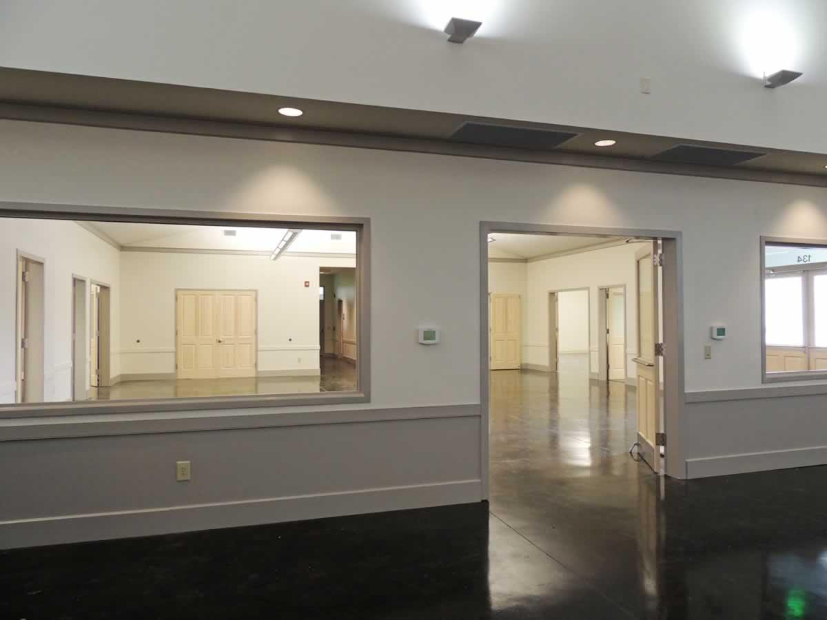 https://jmusselmanconstruction.com/wp-content/uploads/2020/08/6-entrance-area-from-church.jpg