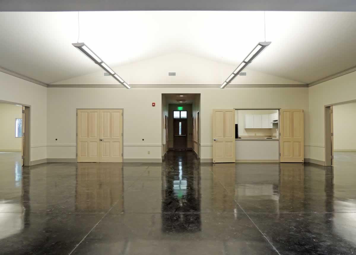 https://jmusselmanconstruction.com/wp-content/uploads/2020/08/7-foyer-to-kitchen-and-hall.jpg
