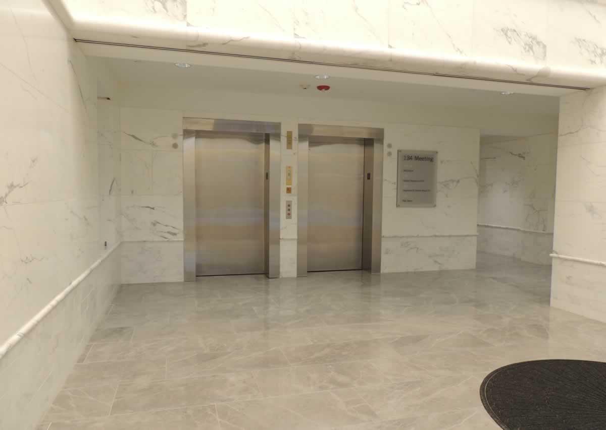 https://jmusselmanconstruction.com/wp-content/uploads/2020/10/Lobby-Elevators.jpg